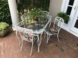 Wrought iron and glass patio table and chairs