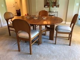 """Ansager Mobler solid teak dining set.  Comes with 6 dining chairs & two leaves.  Extends from a 47"""" circle(not photographed) to 87"""" long"""