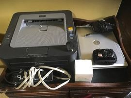 Brother LaserJet printer, Dell Inspiron laptop,  Digital camera.