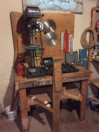 Delta Bench Drill Press, Loads of cased bits, jacks, workbench & saw blades and so much more in this room!
