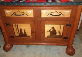 Details of Hand carved buffet front. It also has a leather top.