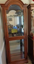Lit Curio Cabinet with glass shelves.