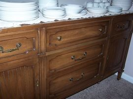 Buffet has top cabinet with glass doors