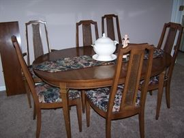 wood table with 6 chairs and 3 leaves