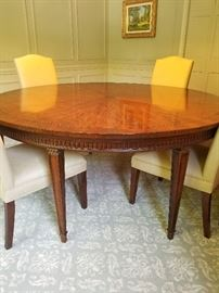 Beautiful round dining table. Can be expanded to oval with one leaf.