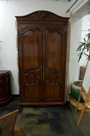 A country French armoire hand carved walnut solids, knotty white oak door and end panel veneers, carved crown and carved base.  By Karges Furniture Co.  (Appraised: $7,500).  For Sale: $1,900