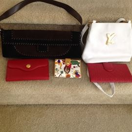 Ferragamo and Paloma Picasso handbags.  Designer wallets.