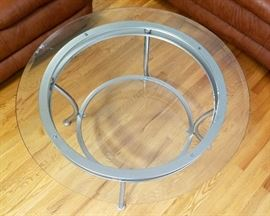 "Beveled glass top, round coffee table, with bottom shelf and brushed aluminum base.  38"" round, 19"" tall"