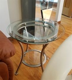 "Pair of beveled glass top, round side tables, with bottom shelf and brushed aluminum bases.  24"" round, 23"" tall"