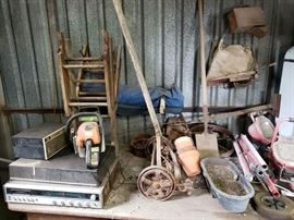 antique mower and record player