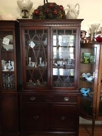 Small, beautiful 1950s china cabinet. Available