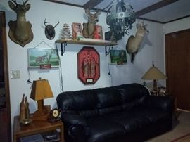 Living Room with Black Sofa and Deer Bust