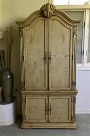 This armoire is very spacious.  Can be used for clothing or for a TV