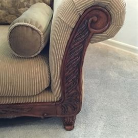 Photo of the carved arm/leg of the sofa