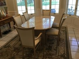Marble look formal dining room table with 8 upholstered chairs