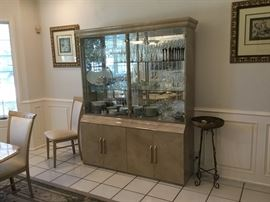 Beautiful neutral china cabinet with glass shelves.  This piece matches the dining room table
