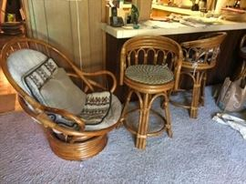 2 Wicker swivel stools, solid high end. chair and one stool has been sold