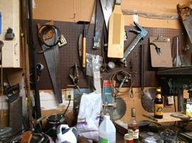 Single car garage full of tools. Saws, hammers, vices, caulking guns, screw drivers, mechanical saws with plates, cleaning supplies, peg board, clip board, sand paper, sanding tools, much more!