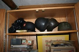 WWII German helmets including two with swastikas.