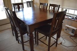 Pub table dining set with 8 chairs.