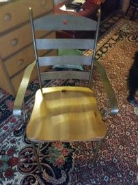 One of four metal and wood chairs