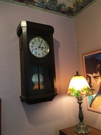 Another clock, lamp , poster.