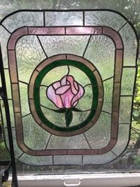 A beautiful piece of stained glass featuring a single rose. The man of the home made beautiful stained glass and we are honored to have numerous pieces included in the sale.