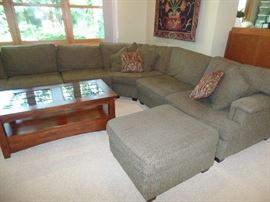 Sectional sofa w/seating for 6 and ottoman - also has a  matching chair and ottoman (coffee table not for sale)
