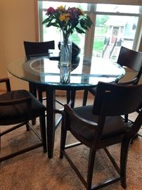 "48"" glass and wood bistro table with four upholstered chairs.  Great Condition - great quality"