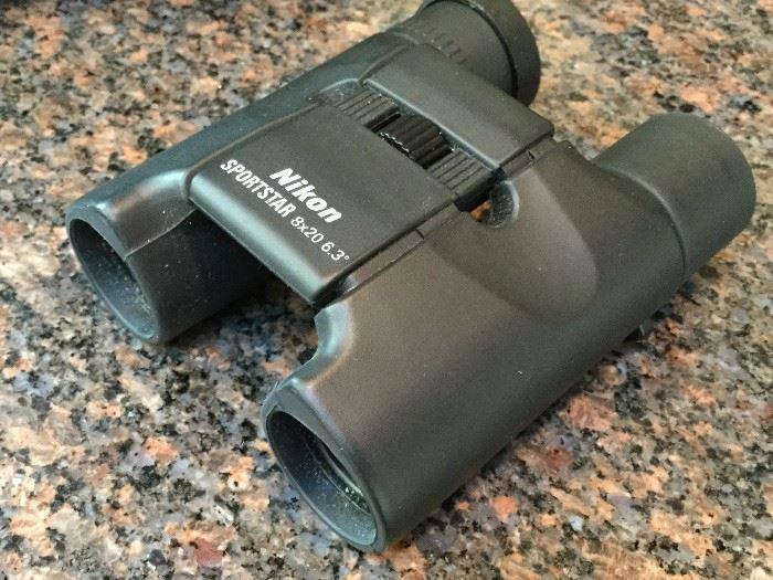 Binoculars, Canon Camera, Lensatic Compass     http://www.ctonlineauctions.com/detail.asp?id=736296