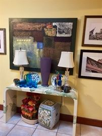 There are so many eclectic treasures in this home...one of my favorites is this vintage eighties hand painted console table...the picture doesn't do it justice!  I also love the photo's taken by the couple's son: an award winning cinematographer.