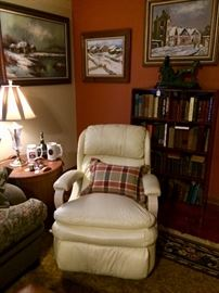 Modern supple leather and bent wood recliner...plus books, pewter, vintage beer steins, in an inviting room filled with snowy landscapes...who knows it's 105 degrees outside