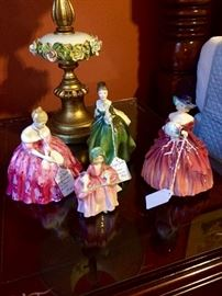 "My nostalgia for Royal Doulton ladies is endless... my grandmother had them when I was a child...beautiful porcelain ""dolls"" I couldn't touch.  Now I can play with them at every sale...still, my daughter arranged these beauties!"
