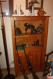 Cabinet, Air Rifles, Floor Lamp, Bookends, Leather horses.