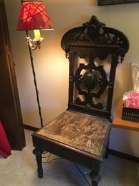 Antique Vintage hand carved wooden chair with tapestry. Seat lifts for storage compartment.
