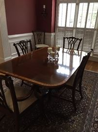 """Dining room table. Measures about: 104"""" long, 44"""" wide. Includes two leaves and pads."""