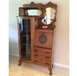 c1900 Golden Oak Side-By-Side China Cabinet / Secretary. Special Traits Are: Curved Glass Door on Cabinet Section, Curved Shelf Supports, Extra Mirror Above Cabinet Section, & Shelf To The Right. Original Hardware.