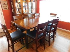 "Solid Oak Dining table and 8 chairs.  8 Foot x 38"" when leaves are extended and 6 foot without leaves"