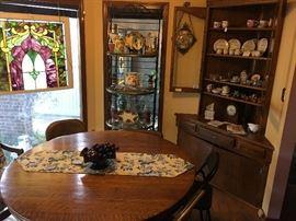 Antique oak table; baker's rack with custom- cut glass shelves.