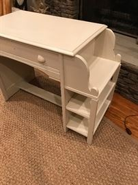 Painted wood desk with shelves.  Drawer opens from both sides.