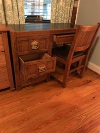 Solid oak desk with matching chair.