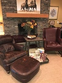 Ethan Allen brown leather chair and ottoman(1978),  Burgundy leather wing chair, oak side table, 1940's leather suitcase.  Ben Hampton's Nancy Ward and Standing Proud signed and numbered prints from 1979.