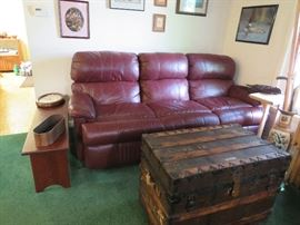 Leather top reclining sofa with a gorgeous Taylor trunk works trunk