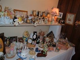 Lots of cat figurines.