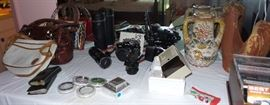35mm camera, lenses and accessories, handbooks, purses, music CDs