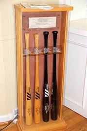 """Set of 4 Pete Rose Bats by Mizuno.  Mizuno Manufactured the """"Hit King's"""" Bats and These are Replicas of The Bats He Used at Key Points in His Career. All Personally Signed by Pete Rose in Beautiful Display Cabinet."""