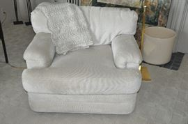"One of a pair of Swaim chenille oyster colored  chairs.  38""w x 27"" h x 34""d."