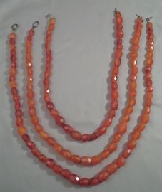 Amazing strands of vintage faceted amber bead necklaces