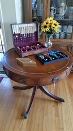 Vintage Mahogany drum table, Vintage silverware set.  Rosaries.