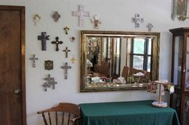 Wall of crosses and wall mirrors